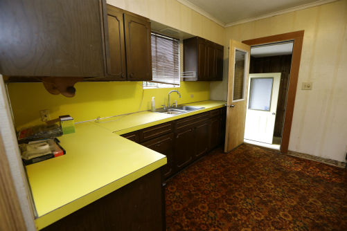 This photo taken on Sept. 23, 2013, shows the kitchen of the childhood home of Kurt Cobain, the late frontman of Nirvana, in Aberdeen, Washington. Cobain&#39;s mother is putting the tired, 1.5-story Aberdeen bungalow on the market this week, the same month as the 20th anniversary of Nirvana&#39;s final studio album. The home, last assessed at less than &#36;67,000, is being listed for &#36;500,000, but the family would also be happy entering into a partnership with anyone who wants to turn it into a museum. &#40;Check out the listing here.&#41; <span class=meta>(theagencyre.com)</span>