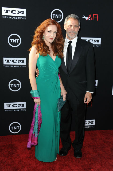Amy Yasbeck, at left, and Michael J. Plonsker walk the red carpet at the American Film Institute&#39;s 41st Lifetime Achievement Gala, honoring Mel Brooks, at the Dolby Theatre in Los Angeles on Thursday, June 6, 2013. Yasbeck, the widow of John Ritter, played Marian in Brooks&#39; 1993 comedy film &#39;Men In Tights.&#39; <span class=meta>(Katy Winn &#47; Invision &#47; AP)</span>