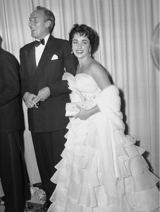 Elizabeth Taylor and her husband, Michael Wilding, appear happy to be among those present to watch the annual Academy Award in Hollywood on March 19, 1953. <span class=meta>(AP Photo)</span>