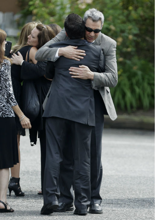 Mourners embrace outside of Robert Spearing Funeral Home for a private viewing for actor James Gandolfini in Park Ridge, New Jersey on June 26, 2013. Gandolfini, who played Tony Soprano in the HBO show &#39;The Sopranos,&#39; died at age 51 while vacationing in Italy.  <span class=meta>(AP Photo &#47; Julio Cortez)</span>