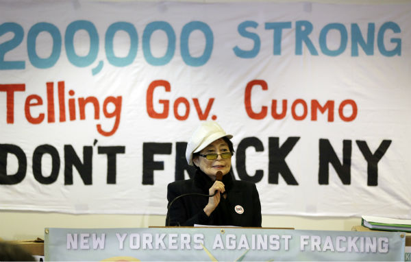 Yoko Ono speaks during a news conference...