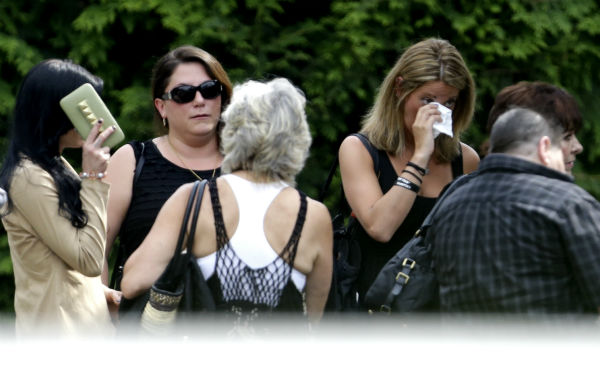 "<div class=""meta ""><span class=""caption-text "">People arrive at Robert Spearing Funeral Home for a private viewing for actor James Gandolfini in Park Ridge, New Jersey on June 26, 2013. Gandolfini, who played Tony Soprano in the HBO show 'The Sopranos,' died at age 51 while vacationing in Italy.  (AP Photo / Julio Cortez)</span></div>"