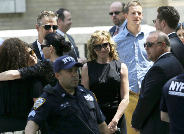 Actress Edie Falco, center, stands outside of Cathedral Church of Saint John the Divine after the funeral service for James Gandolfini in New York on June 27, 2013. Gandolfini, who played Tony Soprano in the HBO show &#39;The Sopranos,&#39; died at age 51 while vacationing in Italy. Falco played his wife, Carmella, in the series. <span class=meta>(AP Photo &#47; Julio Cortez)</span>