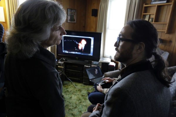 Sean Lennon talks with anti-fracking activist Vera Scoggins as they view videos of fracking, in Franklin Forks, Pennsylvania on Jan. 17, 2013.