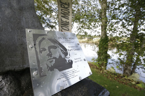 In this photo taken on Sept. 23, 2013, a sign at Kurt Cobain Landing, a tiny park blocks from the childhood home of Kurt Cobain, the late frontman of Nirvana, honors him as it overlooks the Wishkah River in Aberdeen, Washington.