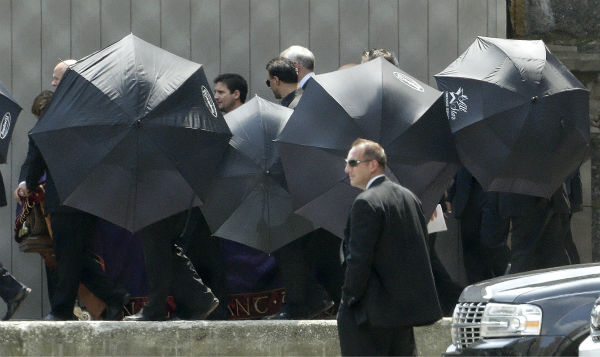Men hold umbrellas as pallbearers walk with a casket containing the body of actor James Gandolfini at Cathedral Church of Saint John the Divine after the funeral service for the actor in New York on June 27, 2013. Gandolfini, who played Tony Soprano in the HBO show &#39;The Sopranos,&#39; died at age 51 while vacationing in Italy.  <span class=meta>(AP Photo &#47; Julio Cortez)</span>