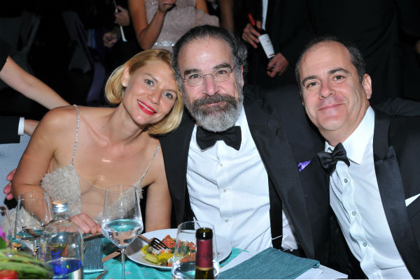 "<div class=""meta image-caption""><div class=""origin-logo origin-image ""><span></span></div><span class=""caption-text"">'Homeland' star and Emmy winner Claire Danes, co-star and nominee Mandy Patinkin and Showtime President David Nevins attend the Emmy Awards 2013 Governors Ball after the 65th Primetime Emmy Awards in Los Angeles on Sept. 22, 2013. (Vince Bucci / Invision for Academy of Television Arts and Sciences / AP Images)</span></div>"