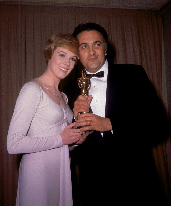 "<div class=""meta ""><span class=""caption-text "">Julie Andrews poses with Italian film director Federico Fellini after presenting him with his Oscar at the 1963 Academy Awards at the Santa Monica Civic Auditorium in Los Angeles, California on April 13, 1964. Fellini won best foreign-language picture Oscar for his movie '8 1/2.' (AP Photo)</span></div>"
