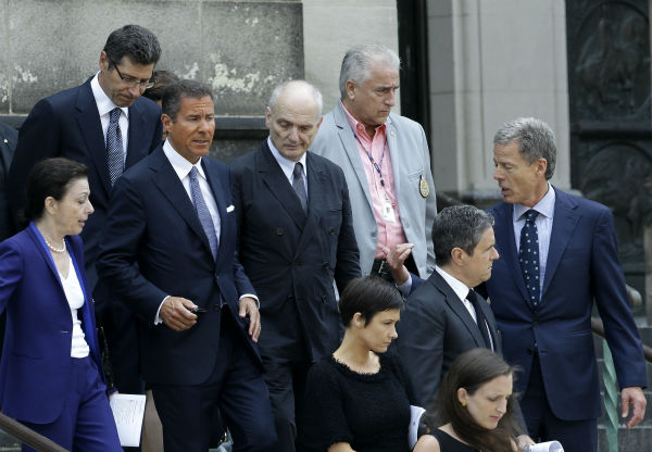 David Chase, center, creator and executive producer of &#39;The Sopranos,&#39; walks out of Cathedral Church of Saint John the Divine with HBO CEO Richard Plepler, center left, after the funeral service for James Gandolfini in New York on June 27, 2013. Gandolfini, who played Tony Soprano in the HBO show &#39;The Sopranos,&#39; died at age 51 while vacationing in Italy.  <span class=meta>(AP Photo &#47; Julio Cortez)</span>