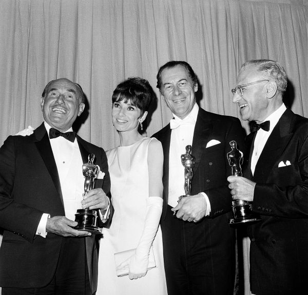 Oscar winners from &#39;My Fair Lady,&#39; from left, Jack Warner, Rex Harrison and George Cukor pose with Audrey Hepburn at the Academy Awards presentations in Santa Monica, California on April 5, 1965.  Producer Warner won the award for best picture of the year. Harrison won best actor. Cukor won best direction. <span class=meta>(AP Photo)</span>