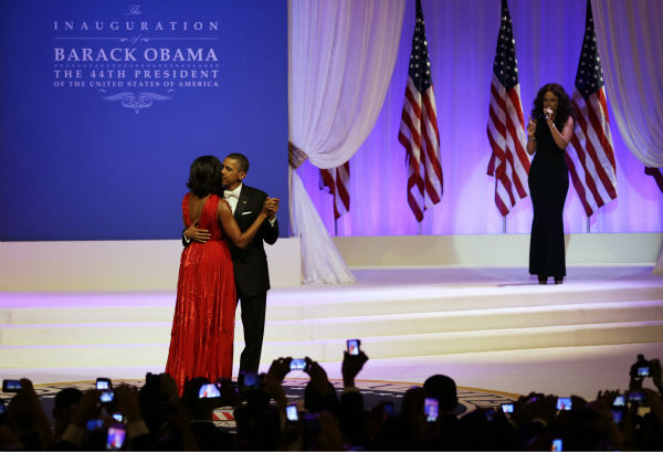 "<div class=""meta ""><span class=""caption-text "">Jennifer Hudson, right, sings while President Barack Obama and First Lady Michelle Obama dance at the Commander-in-Chief's Inaugural Ball at the 57th Presidential Inauguration in Washington on Jan. 21, 2013. (AP Photo / Jacquelyn Martin)</span></div>"