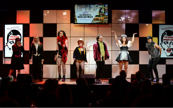 From left, actors Mayim Bialik, Simon Helberg, Jim Parsons, Melissa Rauch, Johnny Galecki, Kaley Cuoco and Kunal Nayyar, of &#39;The Big Bang Theory,&#39; perform &#39;The Time Warp&#39; from &#39;The Rocky Horror Picture Show&#39; at the 21st annual &#39;A Night at Sardi&#39;s&#39; benefit for the Alzheimer&#39;s Association at the Beverly Hilton Hotel on March 20, 2013. <span class=meta>(Jordan Strauss &#47; Invision for Alzheimer&#39;s Association &#47; AP Images)</span>