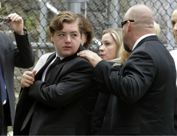 "<div class=""meta image-caption""><div class=""origin-logo origin-image ""><span></span></div><span class=""caption-text"">Michael Gandolfini, the 13-year-old on of James Gandolfini, arrives for the funeral service of his father, star of 'The Sopranos,' in New York's Cathedral Church of Saint John the Divine on June 27, 2013. The 51-year-old actor died of a heart attack last week while vacationing in Italy with him. (AP Photo / Richard Drew)</span></div>"