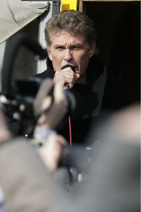 David Hasselhoff speaks to the crowed from a truck as he attends a protest against the removal of a section of the East Side Gallery, a historic part of former Berlin Wall, in Berlin on Sunday, March 17, 2013. Hasselhoff is fondly remembered by many Germans for releasing a song called &#39;Looking for Freedom&#39; shortly before the fall of the Wall in 1989. <span class=meta>(AP Photo &#47; Markus Schreiber)</span>