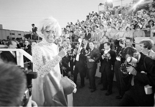"<div class=""meta image-caption""><div class=""origin-logo origin-image ""><span></span></div><span class=""caption-text"">Carol Channing arrives for the 1967 Academy Awards ceremony at the Santa Monica Civic Auditorium in Santa Monica, California on April 10, 1968. Channing is nominated for best actress in a supporting role for 'Thoroughly Modern Millie.' (AP Photo)</span></div>"