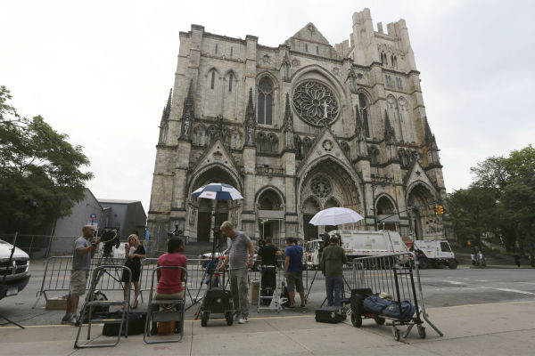 Reporters set up outside the Cathedral Church of Saint John the Divine for the funeral service of James Gandolfini in New York on June 27, 2013. Gandolfini, who played Tony Soprano in the HBO show &#39;The Sopranos,&#39; died at age 51 while vacationing in Italy.  <span class=meta>(AP Photo &#47; Mary Altaffer)</span>