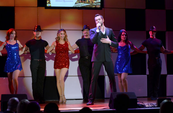 Zachary Levi, third from right, and Keltie Colleen, third from left, perform at the 21st annual 'A Night at Sardi's' benefit for the Alzheimer'