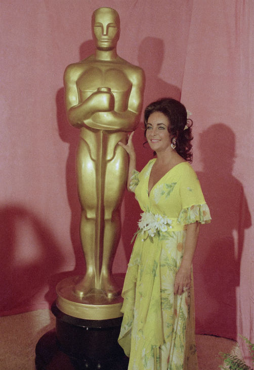 Elizabeth Taylor is seen standing by a statue of the Academy Award Oscar on April 2, 1974, in Los Angeles. <span class=meta>(AP Photo)</span>