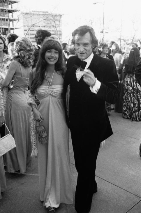 Hugh Hefner, founder and publisher of Playboy Magazine, right, arrives with Barbi Benton for the Academy Awards on April 2, 1974, Los Angeles, California. <span class=meta>(AP Photo)</span>