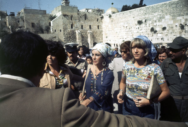 Elizabeth Taylor visits the Western Wall in Jerusalem during her visit to Israel on Aug. 28, 1975. Orthodox Jewish regulations at the holy site dictate that men and women must be separated there. Her partner Richard Burton was at another sector. <span class=meta>(AP Photo)</span>