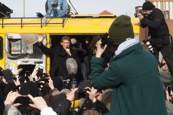"<div class=""meta image-caption""><div class=""origin-logo origin-image ""><span></span></div><span class=""caption-text"">David Hasselhoff, center, speaks to the crowed  from a truck as he attends a protest against the removal of a section of the East Side Gallery, a historic part of former Berlin Wall, in Berlin on Sunday, March 17, 2013. Hasselhoff is fondly remembered by many Germans for releasing a song called 'Looking for Freedom' shortly before the fall of the Wall in 1989. (AP Photo / Markus Schreiber)</span></div>"
