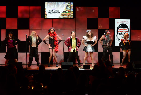 From left, actors Mayim Bialik, Simon Helberg, Jim Parsons, Johnny Galecki, Kaley Cuoco, Kunal Nayyar and Melissa Rauch, from the cast of 'The Big Bang Theory,' perform 'The Time Warp' from 'The Rocky Horror Picture Show' at the 21st annua
