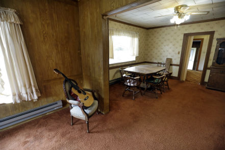 This photo taken on Sept. 23, 2013, shows a guitar, staged for the home sale, and the dining room table and hutch from when Kurt Cobain, the late frontman of Nirvana, lived there in Aberdeen, Washington. Cobain&#39;s mother is putting the tired, 1.5-story Aberdeen bungalow on the market this week, the same month as the 20th anniversary of Nirvana&#39;s final studio album. The home, last assessed at less than &#36;67,000, is being listed for &#36;500,000, but the family would also be happy entering into a partnership with anyone who wants to turn it into a museum. &#40;Check out the listing here.&#41; <span class=meta>(AP Photo &#47; Elaine Thompson)</span>