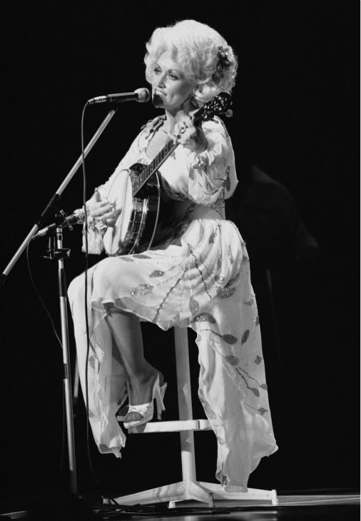 American singer Dolly Parton performs during her Tokyo concert on Monday, July 30, 1979. The popular vocalist, who won a Grammy award that year, sang 20 songs before a crowd of 1,600.  <span class=meta>(AP Photo)</span>