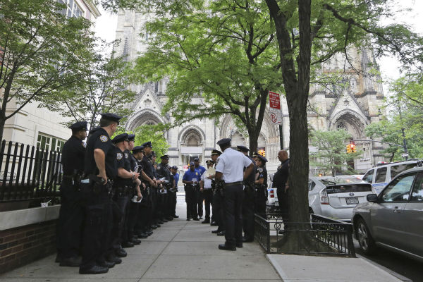 Police officers stage in front of the Cathedral Church of Saint John the Divine ahead of the funeral service of James Gandolfini in New York on June 27, 2013. Gandolfini, who played Tony Soprano in the HBO show &#39;The Sopranos,&#39; died at age 51 while vacationing in Italy.  <span class=meta>(AP Photo &#47; Mary Altaffer)</span>