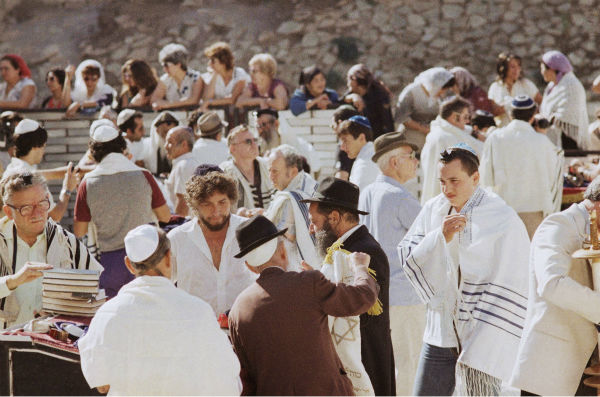 Singer Bob Dylan &#40;left&#41; attends the Bar Mitzvah of his son Jesse, right, at the Western Wall in Jerusalem on Sept. 20, 1983. <span class=meta>(AP Photo &#47; Zavi Cohen)</span>