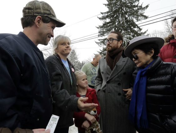 Sean Lennon, second right, and his mother Yoko Ono, right, visit with Matthew, left, and Tammy Manning, in Franklin Forks, Pennsylvania on Jan. 17, 2013.