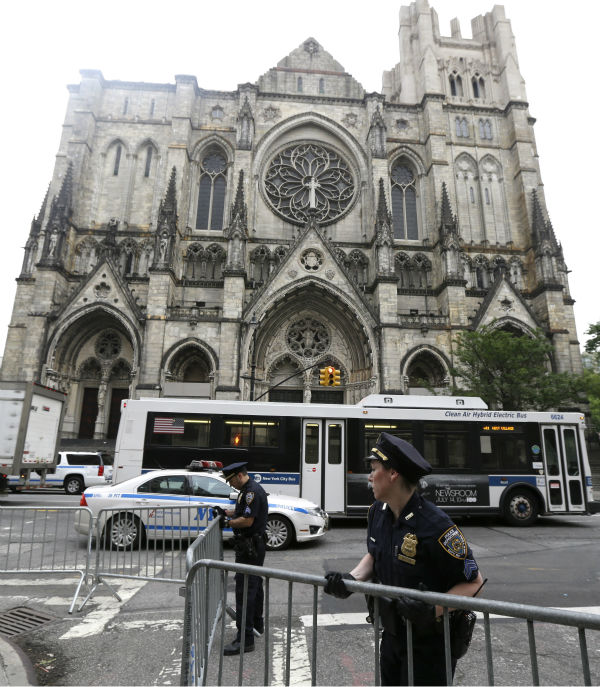 New York Police officers arrange barricades across the street from Cathedral Church of Saint John the Divine before the funeral service of James Gandolfini in New York on June 27, 2013. Gandolfini, who played Tony Soprano in the HBO show &#39;The Sopranos,&#39; died at age 51 while vacationing in Italy.  <span class=meta>(AP Photo &#47; Julio Cortez)</span>
