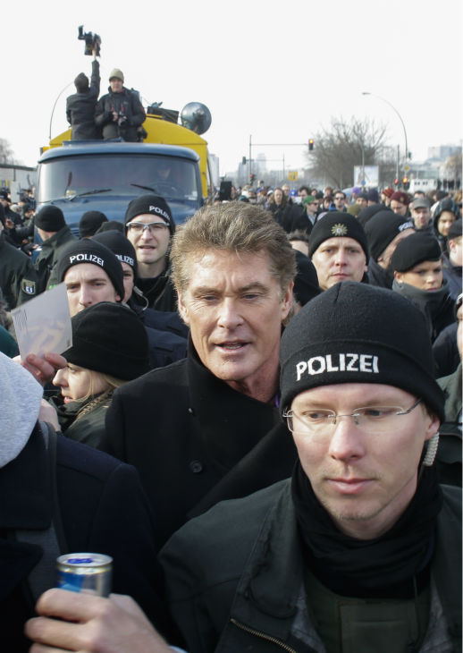 David Hasselhoff, center, is surrounded by police officers as he attends a protest against the removal of a section of the East Side Gallery, a historic part of former Berlin Wall, in Berlin on Sunday, March 17, 2013. Hasselhoff is fondly remembered by many Germans for releasing a song called &#39;Looking for Freedom&#39; shortly before the fall of the Wall in 1989. <span class=meta>(AP Photo &#47; Markus Schreiber)</span>