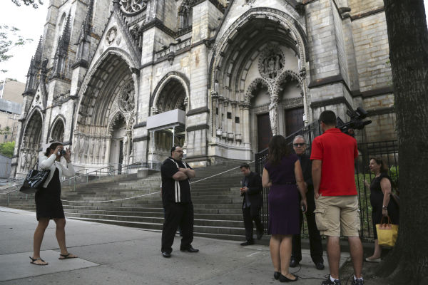 "<div class=""meta ""><span class=""caption-text "">Reporters interview members of the public outside the Cathedral Church of Saint John the Divine for the funeral service for James Gandolfini in New York on June 27, 2013. Gandolfini, who played Tony Soprano in the HBO show 'The Sopranos,' died at age 51 while vacationing in Italy. (AP Photo / Mary Altaffer)</span></div>"