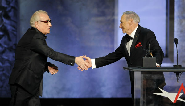 "<div class=""meta image-caption""><div class=""origin-logo origin-image ""><span></span></div><span class=""caption-text"">Honoree Mel Brooks, right, shakes hands with presenter Martin Scorsese during the American Film Institute's 41st Lifetime Achievement Award Gala at the Dolby Theatre in Los Angeles on Thursday, June 6, 2013. (Chris Pizzello / Invision / AP)</span></div>"