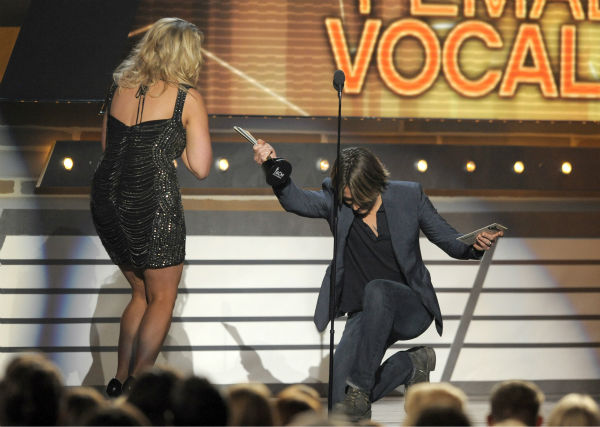Keith Urban, right, presents the award for female Vocalist of the Year to Miranda Lambert at the 48th annual Academy of Country Music &#40;ACM&#41; Awards. The ceremony was co-hosted by Luke Bryan and Blake Shelton and was broadcast live from the MGM Grand Garden Arena in Las Vegas on CBS on Sunday, April 7, 2013. <span class=meta>(Chris Pizzello &#47; Invision &#47; AP)</span>