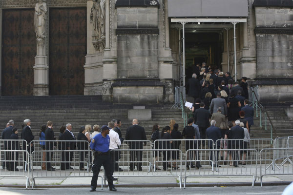 People arrive at the the Cathedral Church of Saint John the Divine for the funeral service of James Gandolfini in New York on June 27, 2013. Gandolfini, who played Tony Soprano in the HBO show &#39;The Sopranos,&#39; died at age 51 while vacationing in Italy. <span class=meta>(AP Photo &#47; Mary Altaffer)</span>