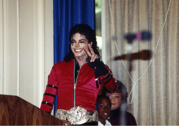 Michael Jackson visits his old Los Angeles school, Gardner Street Elementary School, and flashes the victory sign on Wednesday, Oct. 11, 1989. The newly refurbished auditorium was dedicated to Jackson. He told the crowd: &#39;This is the happiest day of my life.&#39; <span class=meta>(AP Photo &#47; Nick Ut)</span>