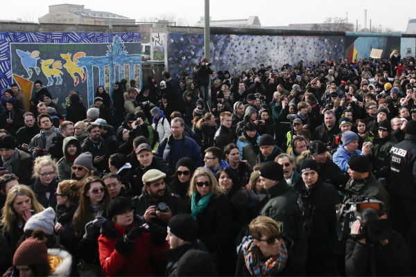 "<div class=""meta ""><span class=""caption-text "">Thousands of protesters follow a truck with David Hasselhoff as he attends a protest against the removal of a section of the East Side Gallery, a historic part of former Berlin Wall, in Berlin on Sunday, March 17, 2013. Hasselhoff is fondly remembered by many Germans for releasing a song called 'Looking for Freedom' shortly before the fall of the Wall in 1989. (AP Photo / Markus Schreiber)</span></div>"