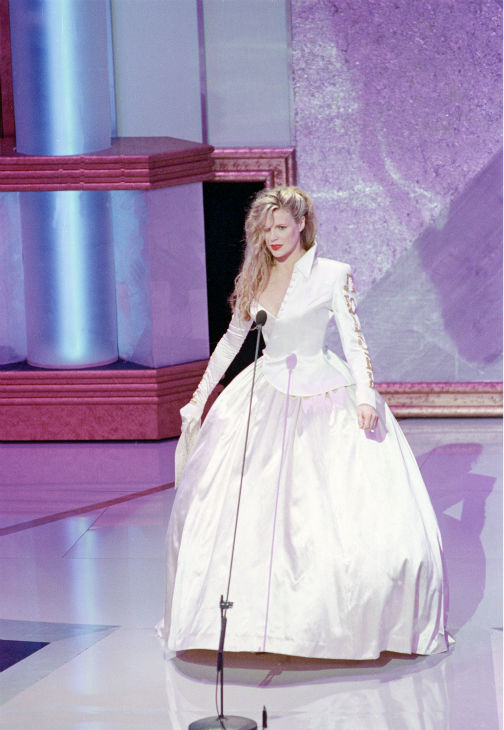 Kim Basinger appears onstage to present an Oscar during the telecast of the 62nd annual Academy Awards at the Dorothy Chandler Pavilion in Los Angeles, California on March 26, 1990.