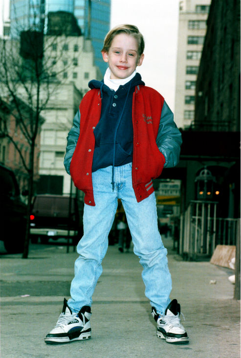 Macaulay Culkin poses on a New York City street...