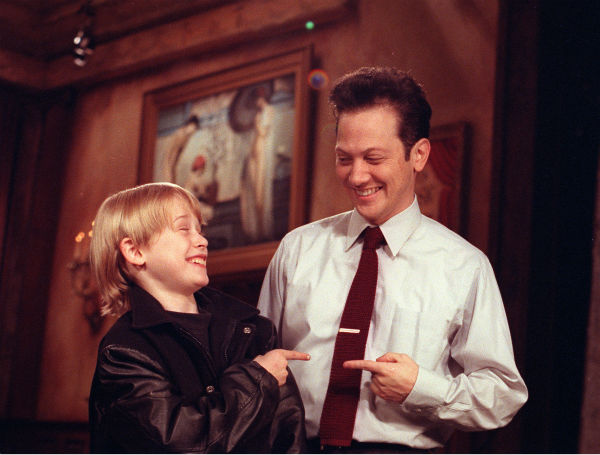 Macaulay Culkin, 11, and 'Home Alone 2: Lost in New York' co-star Rob Schneider point at each other and laugh during a rehearsal for the 'Saturday Night Live' in New York City, Thursday, Nov. 22, 1991.