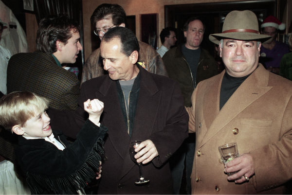 Macaulay Culkin, left, clowns with his 'Home Alone 2: Lost in New York' co-star Joe Pesci, right, in a pre-production party for the cast and crew at the restaurant Planet Hollywood in New York on Dec. 7, 1991.