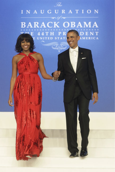 President Barack Obama and First Lady Michelle Obama arrive at the Inaugural Ball at the Washington Convention Center during the 57th Presidential Inauguration in Washington on Jan. 21, 2013. <span class=meta>(AP Photo &#47; Charles Dharapak)</span>