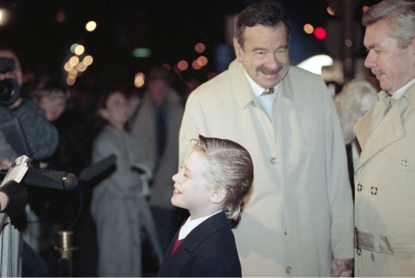 Actor Walter Matthau taps Macaulay Culkin under the chin as they paused for photographers before a screening of 'Home Alone 2: Lost in New York' on Nov. 14, 1992, in Chicago. Matthau was at the time filming the movie 'Dennis the Menace' in the city.