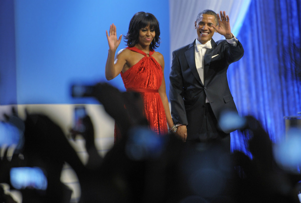 First Lady Michelle Obama dances with President Barack Obama during the Inaugural Ball at the Washignton convention center during the 57th Presidential Inauguration in Washington, on Jan. 21, 2013. Michelle is wearing a red velvet and chiffon Jason Wu gown. <span class=meta>(AP Photo &#47; Cliff Owen)</span>