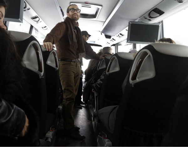 Sean Lennon looks out the windows aboard a bus visiting fracking sites in Franklin Forks, Pennsylvania on Jan. 17, 2013. <span class=meta>(AP Photo &#47; Richard Drew)</span>