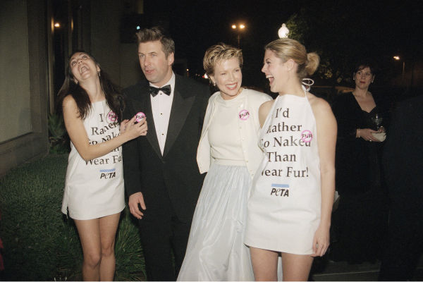 Janet Friedman, far left, and Carla Commagere, far right, pin anti-fur pins on actors Kim Basinger, second from right, and Alec Baldwin during the 1996 Animals Ball and Humanitarian Awards Gala on Dec. 14, 1996 in Los Angeles. The gala, staged by People For The Ethical Treatment of Animals, was hosted by Baldwin and Basinger. <span class=meta>(AP Photo &#47; Rene Macura)</span>