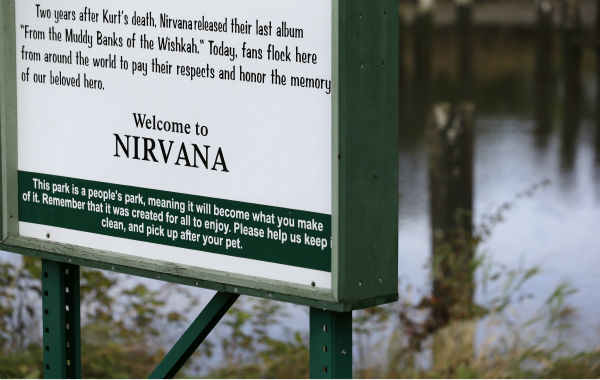 This photo taken on Sept. 23, 2013, shows a sign for Kurt Cobain Landing, a tiny park blocks from the childhood home of the late frontman of Nirvana, overlooking the Wishkah River in Aberdeen, Washington.