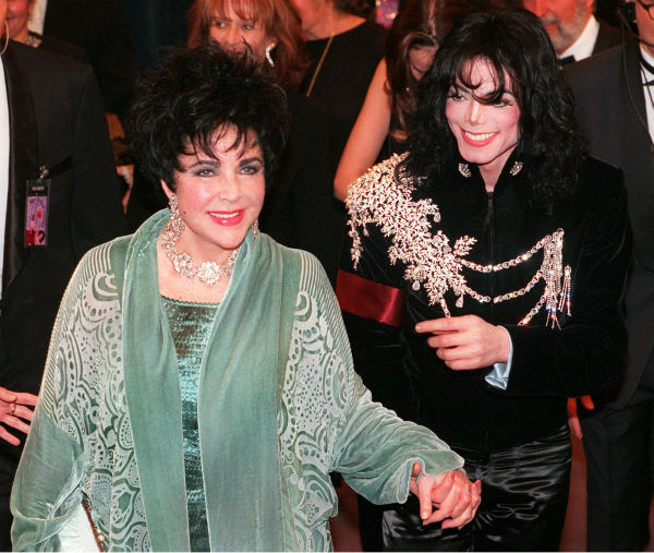 "<div class=""meta image-caption""><div class=""origin-logo origin-image ""><span></span></div><span class=""caption-text"">Elizabeth Taylor arrives with her friend Michael Jackson at the Pantages Theater in the Hollywood area of Los Angeles on Feb. 16, 1997, prior to the start of a 65th birthday celebration for the actress. (AP Photo / Chris Pizzello)</span></div>"
